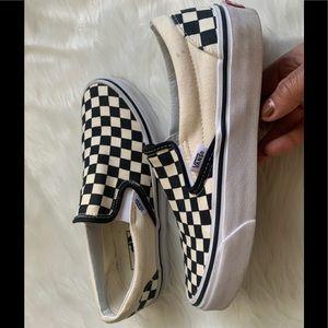 Vans checker board slip ons